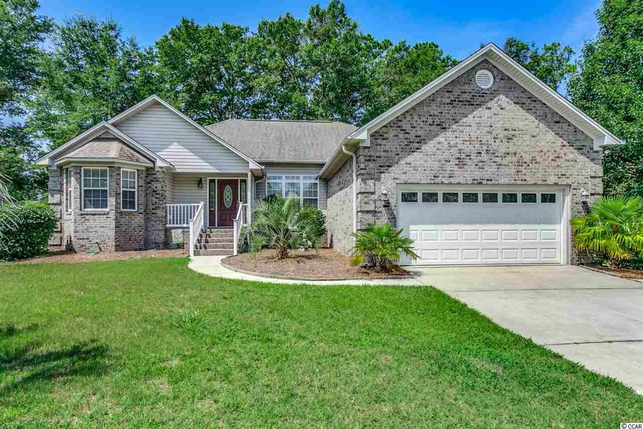 Amazing opportunity to purchase this 3bd/2bth all brick home in the Exclusive Gated Intercoastal Waterway Community of Big Landing. 2379 Island Way features include a formal dining room, additional office/study room with bay window, single level home with no stairs, split bedroom plan, fireplace & Vaulted/Cathedral ceiling in the living area, granite counter tops in the kitchen, hardwoods in the foyer & dining area, laundry room, tile flooring in the bathrooms. Exterior features include a large sun deck out back for entertainment & grilling, and a spacious fenced-in backyard. Big Landing is a gated community with a clubhouse, pool, and a large fishing pier on the Intercoastal Waterway with 2 day docks. This community is truly a hidden gem yet located close to all the shopping, dining, entertainment, golf, area attractions, and the beautiful Atlantic Ocean w/ 60 miles of white sandy beaches! Don't miss ~ come live the dream!
