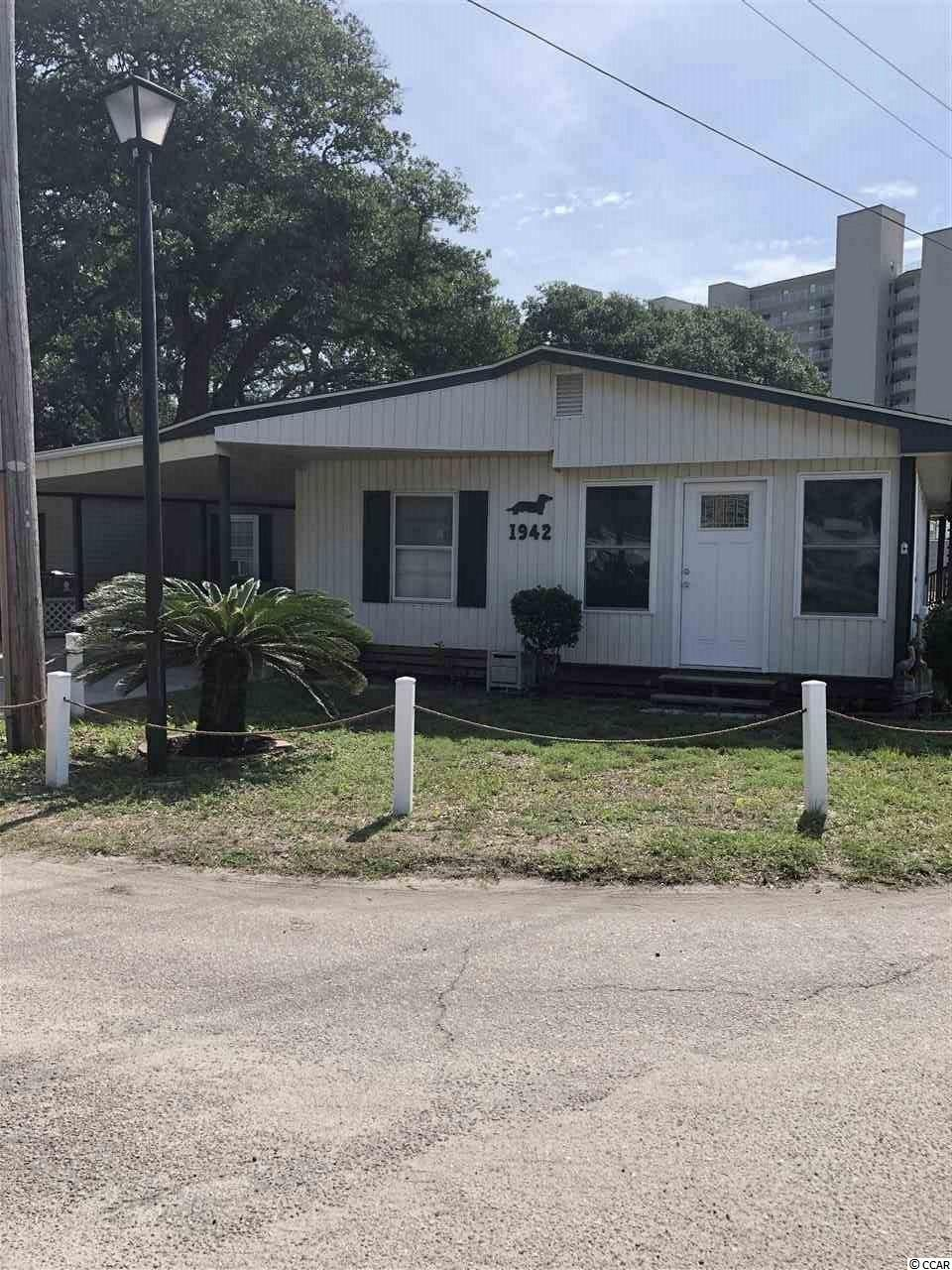 Spacious 3 bed 1 & 1/2 bath home, with den  2 blocks from beach.  Large den with multiple windows allowing natural light in. Open concept floor plan  gives plenty of space for guest.  Large living room just off the kitchen connecting to the den.  Enjoy the sights and sounds of the ocean on the top deck with views of the beach.   Can be used as a vacation rental. Home includes access to Oceanside amenities including, private beach access and parking, 24 hour security, 2 outdoor pools, spa hot tub, splash pad, kiddie pools, heated indoor pool, library, fitness center,community center, basketball court, stocked fishing ponds, picnicking areas, volleyball court, bocce ball and horseshoe pit, and children's playground.