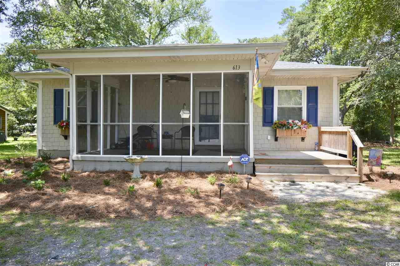 Enjoy this cozy classic beach cottage just blocks from the ocean. Full of upgrades including new roof, remodeled bathrooms, new kitchen cabinets with granite counter tops, HVAC, windows, plumbing, laundry room, rear deck, fenced in back yard, screened in porch, outdoor shower. All this and yet home has original knotted pine floors, walls and ceilings for that classic look. NO HOA. Enjoy the coastal lifestyle, relax and unwind in this exceptionally rare, one of a kind beach cottage tucked away in the Windy Hill section of N Myrtle Beach. Close to shopping, dining and all the entertainment Myrtle Beach has to offer.  Square footage is approximate and not guaranteed.  Buyer is responsible for verification.