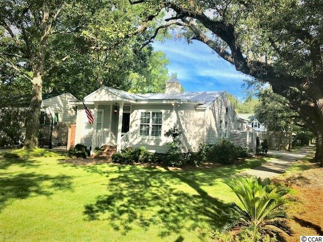 "Lowcountry ""Coastal Cottage"" at its best! Incredible total renovation in 2015 of a cottage located on a beautiful tree lined street in Historic Downtown Georgetown just 2 blocks from the Bay and close by marinas and boat landing. Enjoy tennis, playground, and walking trails as offered at East Bay Park as well as a walk to the Historic waterfront. This lovely home offers  hardwoods, recessed lighting, 2 fireplaces, granite, stainless appliances with gas cook top, crown molding throughout, hardiplank siding, and galvalume metal roof. Fun family room with fireplace and great outdoor space for entertaining. Garage will accomodate a 20 ft boat as well as plenty of storage. Almost 600 sq ft for future expansion above the garage plumbed and ready to go. Must see to fully enjoy the beauty of this property. Could be a great second home as well!!"