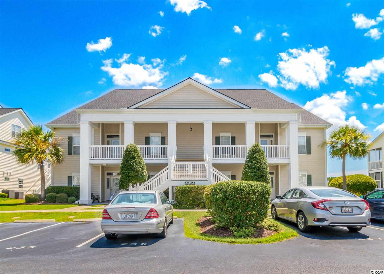 Immaculate 4 Bedroom, 3 Bath two story luxury condo which includes cathedral ceilings, architectural details, Plantation shutters, fireplace, two rear porches overlooking a tranquil lake (one screened, one open), an oversized loft and much more.  Call today to set up your showing!