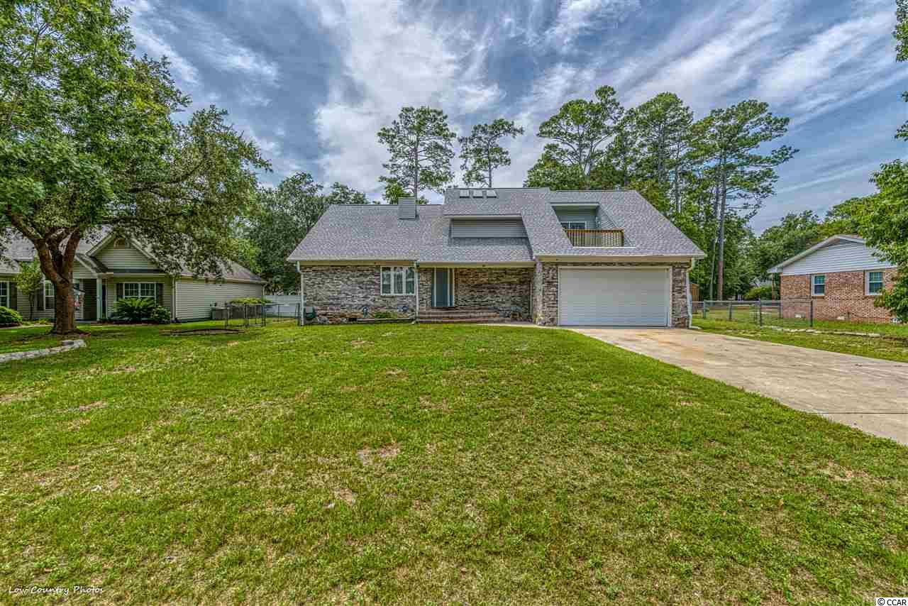 Beautiful completely remodeled traditional all brick home with 3 bedrooms and 2 1/2 bathrooms.  Enter into the foyer which opens into the living room with vaulted ceilings and a fireplace. There is a formal dining room, open kitchen to the eat in area and family room and then out to the Carolina Room overlooking the enormous fenced in yard. There is a 1/2 bath downstairs and a very large laundry room which then takes you to the 2 car oversized garage. Upstairs you will find an entire master suite with front veranda and rear deck, walk in closet with additional storage. The master bath features 2 sinks and and a very large and inviting walk in shower as well as 2 additional spacious bedrooms.  No HOA.  .31 Acre with a shed on the property as well as a gated side entry for your boat, RV or other recreational toys just 4 blocks to the great Atlantic and soft sandy beaches. You don't want to miss this opportunity!
