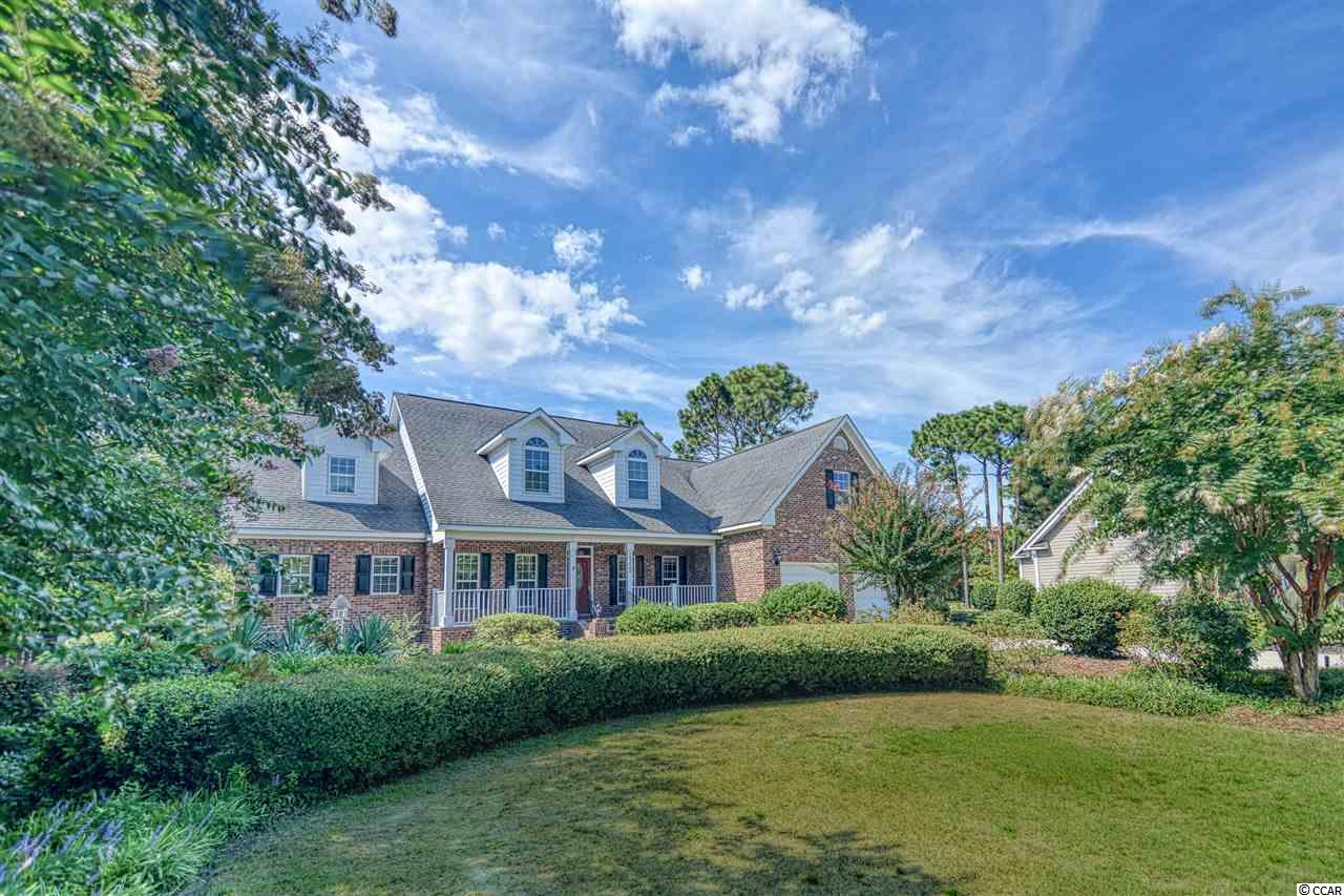 GORGEOUS 5bd/4.5ba executive-style all brick home, almost 1/2 acre lot and ON THE GOLF COURSE w 2 EXTRA BONUS/FLEX spaces.  Extremely PRIVATE and EXPANSIVE backyard deck and extended patio in Prestigious, Gated Community of Prestwick – only 5 mins to the beach! Great Multi-generational home becuase there is 2500 htd sqft of living on the 1st floor alone which includes 1st FLOOR MASTER, a Junior or Guest Suite, craft/gift room, laundry room, living room, formal dining, & eat-in kitchen. Half acre lot with views of the golf course from the front AND back porch! 3 beds AND 2 bonus spaces upstairs which could easily be used for: media room, kid's play room, gym, library, art studio, or 6th & 7th beds! Large eat-in kitchen with granite counters & stainless steel appliances, hardwood & tile floors, fireplace, over-sized 2-car garage, & lots of extra storage spaces. Prestwick is a gated community that features a golf course designed by Pete Dye, 13 tennis courts, junior Olympic pool, restaurant and pro shop. Just minutes to beautiful beaches, public piers, marinas, boat landings, public parks & restaurant/shops. Located just south of everything Myrtle Beach has to offer including: Myrtle Beach International Airport, The Market Common, Coastal Grande Mall, Tanger Outlet Centers, Over 80 golf courses, 5 major hospitals and 2 colleges.