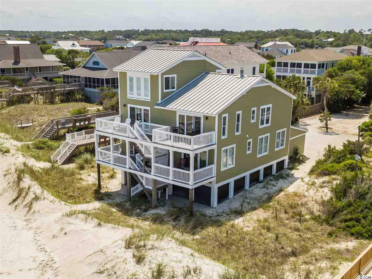 Panoramic Oceanfront views invite you to sit back and relax on one of the multiple front decks. RECENTLY RENOVATED- top to bottom/and  inside and out with meticulous care- this Luxury home is on the premier north end of Pawleys Island. Turn-key, its beautifully decorated and comes furnished, ready for you now! Come take a peek at all the new renovations-Gorgeous chef's kitchen to delight with new granite counters, center Island, new appliances, cabinets, new lighting. The kitchen was opened up to include a 2nd den/conversation room. All bathrooms  completely renovated,  include ship lapped walls and new vanities, lighting etc.  Too many things to list.  Entertaining is a breeze with all the open space and sliding doors that open to decks. Another space to entertain on a top loft. Updates include new windows, doors, painting inside and out, replaced back deck and decking supports. With A total of 6 bedrooms plus a loft w 2twins, this home easily sleeps 14.  Three of the bedrooms have oceanfront decks. A rare find, this home would be perfect for a primary residence or 2nd home. 4th of July Parade marches right in front.