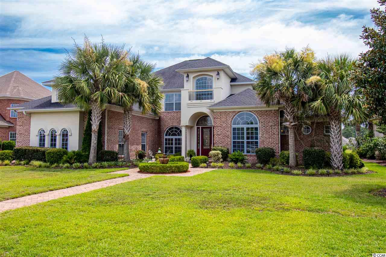 A stunning, custom-designed home in highly sought after Plantation Lakes. This elegant lakefront home sits on 3/4 acres. Having 4 bedrooms, 3 ½ baths, formal living room and dining room, family room, office, kitchen with breakfast nook and a bonus room. The first-floor feature a formal dining room, an office with a current storm built-in wall of bookcases and storage for printers, two file drawers, and a spacious desktop. The formal living room has an elegant floor-to-ceiling engraved stone fireplace, tinted overhead bay windows, and double glass sliding doors. The first-floor master suite wing has a double-sided fireplace, for the bedroom and a cozy sitting room with a bay of windows overlooking the lake. The master bath has his and her spacious walk-in closets, his and her vanities, and an over-sized soaking jetted Jacuzzi bathtub, with a fountain at its head. The entire back of the bathroom is the shower. Beyond the three-car garage is a walled-in courtyard and a private side entrance off the paver driveway. This service area contains a large laundry room and a drop zone across from the elevator. The state-of-the-art gourmet kitchen with gorgeous cherry wood custom cabinets, a Wolf range, custom shelving in the pantry, granite counter-tops and stainless appliances including a wine cooler in the butlers area of the kitchen. Completing the first floor is an open concept area flanking the kitchen-with a spacious breakfast nook and the family room. A bay of windows and French doors enable a full view of the lake. The family room large fireplace with a granite mantle is flanked by custom bookcases with extra storage below. The second level is accessed by the el giant wood staircase or the elevator if you or your guests are carrying luggage or other items. A second master suite with a balcony overlooking the lake has a Brazilian Cherry wood floor with a walk-in closet. This room leads to the bath and an adjacent sitting room or extra bedroom. Across the wood-floored ha