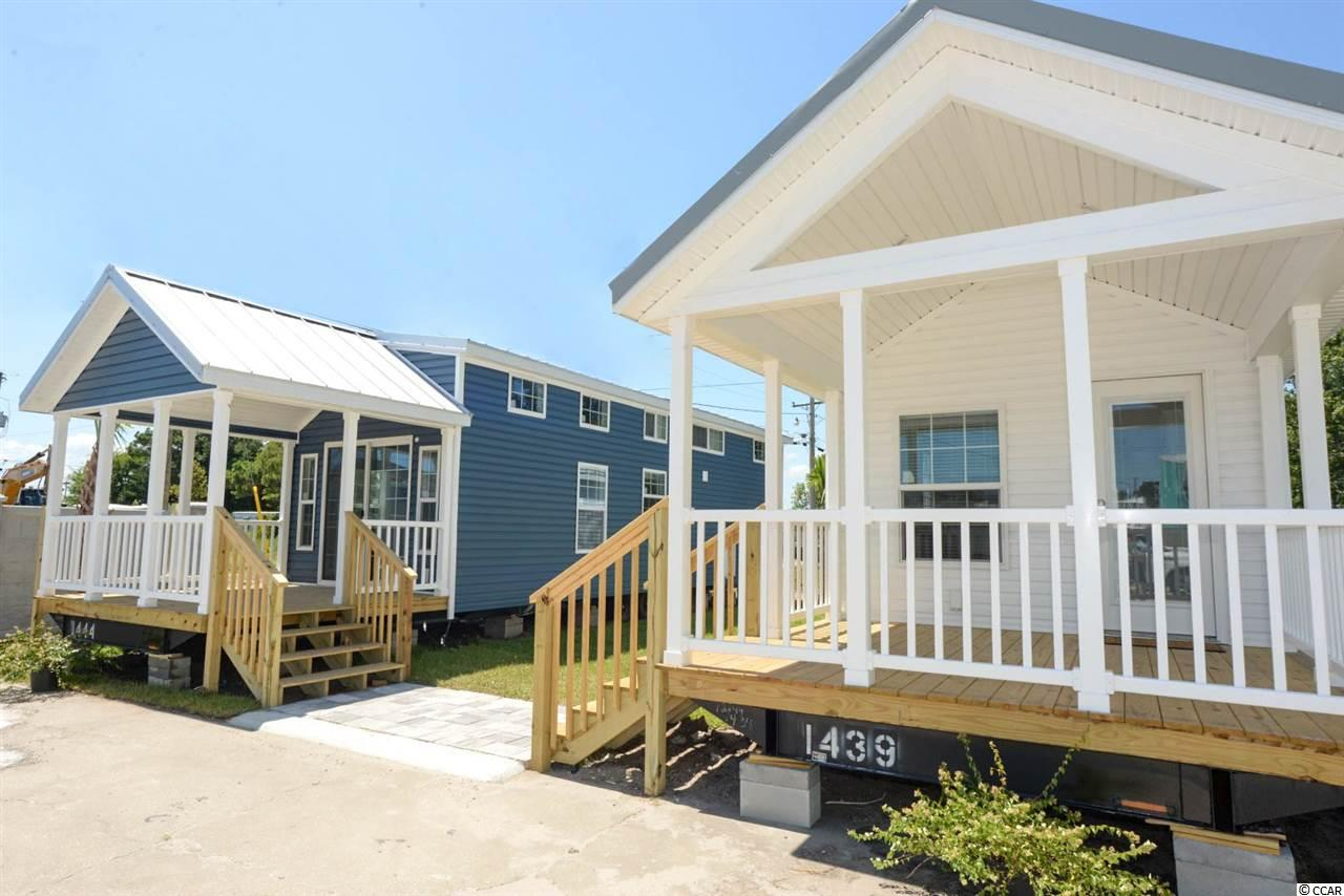 "Tiny Beach Homes! The Palms at Windy Hill is a gated beach community about ½ mile to the beach in the Windy Hill section of North Myrtle Beach, offering Park Model RV homes with lots of style. We offer fantastic amenities and are committed to relaxation, a worry-free home and a simple lifestyle. Golf cart to the beach, Barefoot Landing and other shopping/restaurants. All of our homes consist of 399 square feet with available lofts and additions. You'll be amazed how nice and open our homes are with great use of space. With four different floor plans and multiple interior options these homes are customizable to each individual's wants and needs. ""Less is more"", these tiny homes are ideal for those looking to downsize and simplify. Affordable lot leases with so much to offer. This is ideal for a beach getaway, second home at a great price. Each home will have a front porch, a metal roof, palm tree and enough room for a car/golf cart. Come check out our models!"