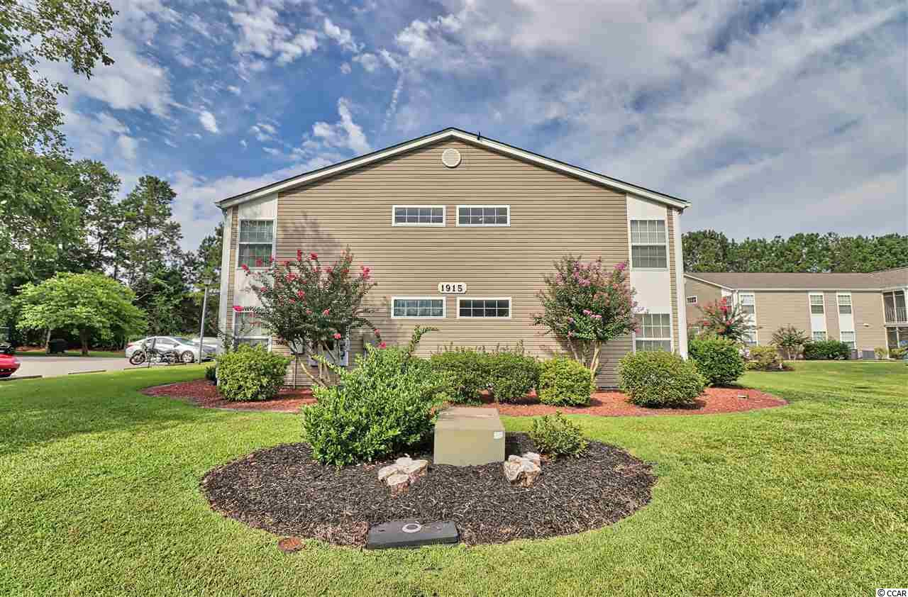 Hampton Greens Condo Community @ Deerfield is located in beautiful Surfside Beach, SC. This condo is a first floor, end unit, and being sold furnished. The building is nestled among trees and a has a pond view. Parking your car or gas powered golf cart is easy. The parking lot is accessible right outside the screened porch and front walkway. Enter the home through the Living Room. Here you will find tile flooring that is also featured through-out the entire unit. A galley style Kitchen with lower height breakfast bar opens to the Dining Area and Living Room. White cabinetry and Stainless-Steel appliances were added to update the Kitchen. A detached, tall pantry is accessible from the Kitchen. There are two bedrooms and two full baths. The Master Bedroom is spacious and has two windows that overlook the private property in the back. Both bathrooms have been updated, and the Master Bath features a ceiling to floor, tiled shower with seat and full, glass shower door. Located off the hallway you will find the laundry room and stack-able washer and dryer, which conveys.  Outside in the screened porch there is a storage area for your beach chairs or other personal belongings. Deerfield is located 2.5 miles and 10 minutes away from the beach and is also a golf cart friendly place. For your shopping or beach needs, you can access both 17 Business and Bypass from the community. There is a swimming pool located outside the building and tennis courts nearby. Come see for yourself and make this your new home or vacation place at the beach!