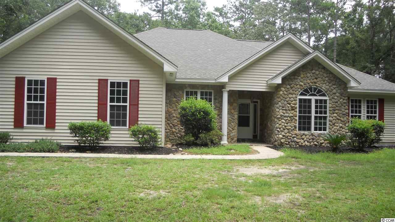 This is a very rare opportunity to own over 5 acres of land within 10 minutes of Myrtle Beach, the ocean, and all the entertainment and dining options.  Ther seller just finished a major rehab of this property.  This included a new roof, new HVAC, new granite countertops in the kitchen and bathrooms, new cabinets in the kitchen, laundry room, and bathrooms, new stainless steel appliances with a gas top range, new flooring throughout the entire home, new paint throughout the home, new light fixtures and ceiling fans, and much much more.  This is a must see opportunity with endless privacy as well as easy access to almost everything you can imagine using the newly completed International Drive.  To help visualize this home's floor plan and to highlight its potential, virtual furnishings may have been added to photos found in this listing.  All measurements and information are approximate and should be verified.