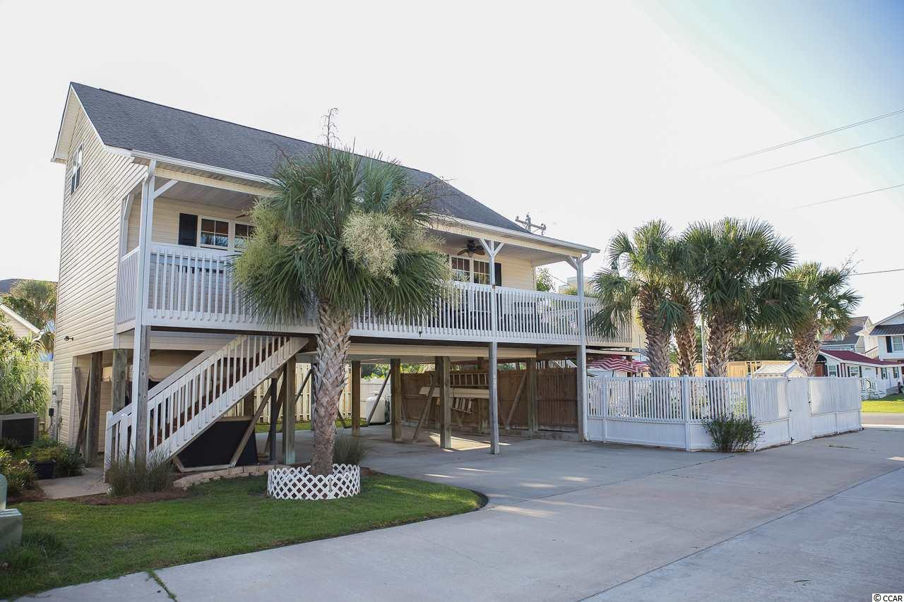 What an amazing opportunity to own this awesome 3 bedroom, 2 bath raised beach home in the Crescent Beach section of North Myrtle Beach with ocean views! This home is perfect for hosting guests! It boasts a serene outdoor entertaining area complete with spacious decks, a fenced in porch and a hot tub! This home is sure to impress. Enjoy looking outside your window and seeing beautiful views of the ocean. You're only 250 steps away from the sandy beaches and putting your toes in the Atlantic Ocean. There is No HOA!!! So it's perfect for an investor or primary residence! LOCATION LOCATION LOCATION... Seconds away from the beach and minutes away from shopping, dining, grocery stores and anything you could ever want or need. Do not miss out on the amazing home!