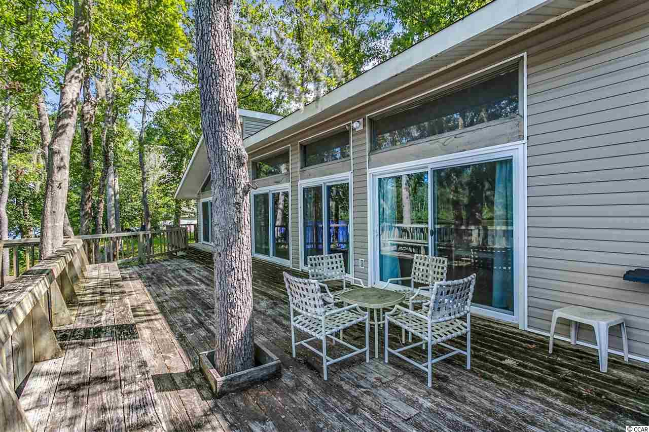 The perfect Black River Retreat with over 140 feet of Black River frontage, 72x14 back deck and 24x8 floating dock. This waterfront beauty offers unbelievable water views from almost every room of the home. Architect designed, built and occupied. Open floor plan with beam vaulted ceilings, double ceiling fans, triple vinyl door sliders in family room leading to back deck, fireplace area with built in entertainment enclosure and triple transom windows allowing plenty of natural sunlight. Beautiful granite counter tops in Kitchen, white solid wood cabinets, smooth top range, recess lighting, pantry and breakfast bar. Jack and Jill guest bath with cabinet style vanity, walk in closets, ceiling fans and double vinyl door slider. Master bedroom suite with large walk in closet, vaulted ceilings, two double vinyl door sliders, tile floor master bath, tile walk in shower with decorative tile accents, double sink and linen closet. Rock base seawall all along the river front, HVAC new in 2017, approx 1/4 miles from the Browns Ferry public boat landing.