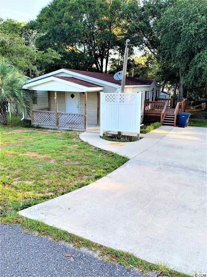 Nice double wide on deeded lot. 1.4 miles from the ocean. No HOA. Close to shopping, restaurants, bars, entertainment & the ICW. Golf cart distance to everything.