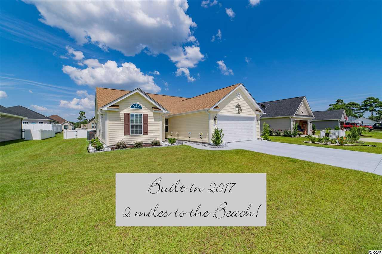 Looking for a newer home and close to the beach?? Stop looking-you found it! This home is 2 years young- built in 2017! Great location in the new section of Mallard Landing Village and located east of Highway 17 Bypass-just a short golf cart ride to the beach (less than 2 miles), shopping and fun! Perfect one level living with an open floor plan features 3 Bedrooms and 2 full Baths! Cathedral Ceiling in the Living Rm/ Formal Dining Rm/Kitchen and in the Master & Bedroom 3! Kitchen w/loads of  Cabinetry, Breakfast Bar and Breakfast area, Front Storm Door, Ceiling Fans, Laundry Room, Fenced Yard and Irrigation system, Patio with Pergola and the list goes on! You don't want to miss this one if location is important to you-it's all about the lifestyle!