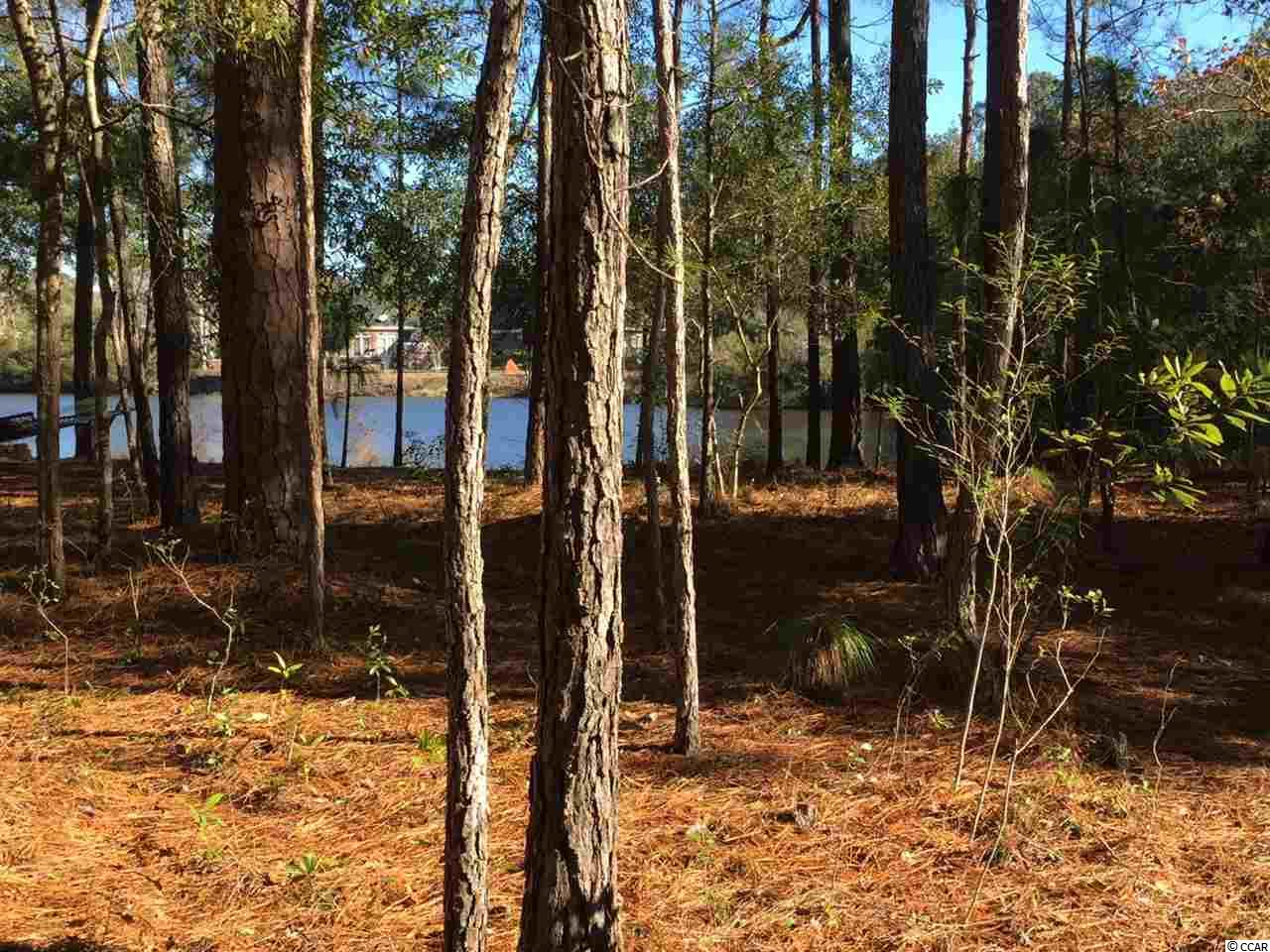 Welcome to this beautiful wooded cul-de-sac lot on the water. It lies within the prestigious and private Huntington Mews West area of The Reserve in Pawleys Island. With no time limit in which to build, this gated, golf and marina community offers a perfect setting for your future primary or second home. Community amenities include access to Litchfield By The Sea, private walking/biking trails, fishing and tennis. It also features an oceanfront clubhouse which includes access to the River Club Pool. Memberships are also available at the private Reserve Harbor Yacht Club with its waterway marina and also the Greg Norman designed golf course.