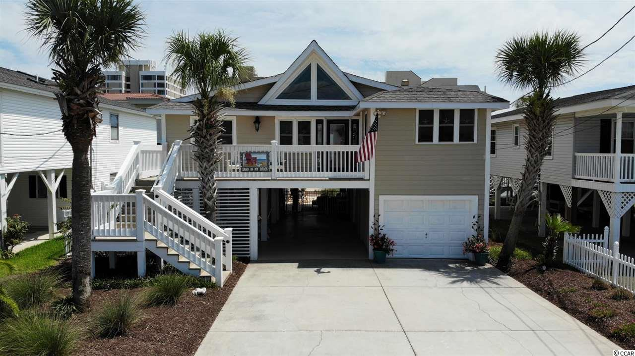 Location, location! Own a piece of Paradise ~ Must see this completely remodeled 5br/3ba raised beach home on the channel, just blocks from the ocean, w/ No HOA fees in the Cherry Grove area of North Myrtle Beach!  This  immaculate home is not a rental, only used as 2nd home and features 4 bedrooms and 2 full baths upstairs and a finished lower level with a bedroom and a full bath with it's own separate entrance - great for rentals or a guest suite, custom kitchen, 2 new HVAC systems 2017, controlled thermostats w/ app, hurricane resistant windows, hot water heater 2016, hardwood floors, landscaping & irrigation, awesome outdoor oasis right on the channel great for entertaining w/ decks, in-ground heated/cooled saltwater pool, porch swing, 2 enclosed outdoor showers,  a standing dock, 1 car garage and hardiplank exterior!  Come relax on the back decks while watching the calming channel and a peek at the ocean which is only 2 blocks away!  On top of this fantastic home you get to enjoy just a short walk or golf cart ride to the beautiful Atlantic Ocean w/ 60 miles of white sandy beaches and close to all of the shopping, dining, entertainment, golf, area attractions and all the beach life has to offer!  Whether a primary residence, an investment or your vacation get-a-way, don't miss ~ come live the Dream!