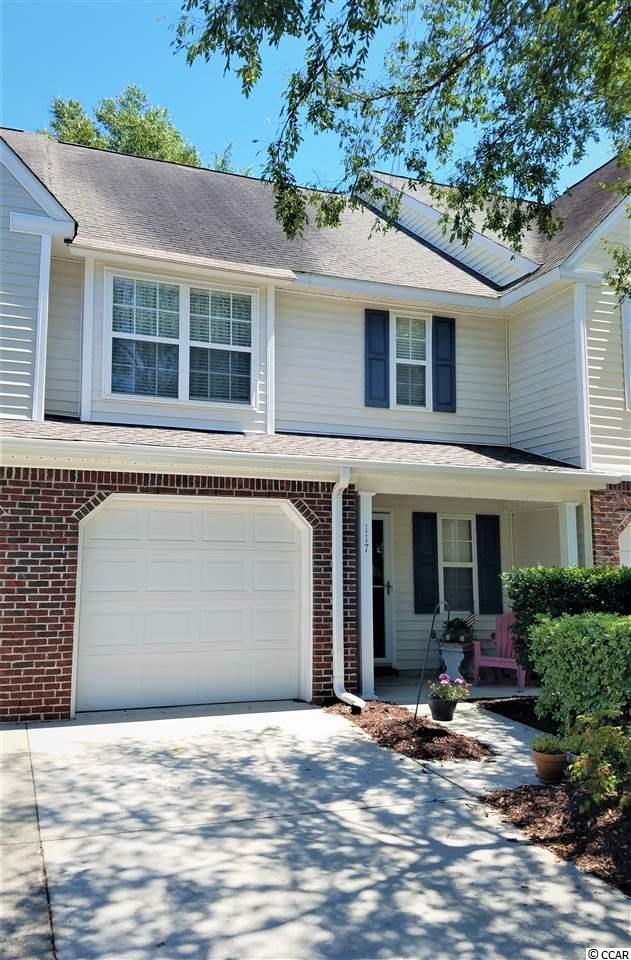 Beautiful and tastefully updated Pawley's Island Townhome.  Centrally located and close to all the best beaches and restaurants of Pawley's Island.  The many updates include the kitchen, all bathrooms, roof, mechanical systems, paint and much more.  Sit in the screened porch off the rear and overlook the pool and the shaded garden.  Great paver patio for outdoor cooking and dining.  This private townhouse even has a one car garage for parking or to help with storage.  The owner has taken great pride in this home and it shows!  Someone will get a great modern, updated home in great condition at a fantastic price.  Let it be you!
