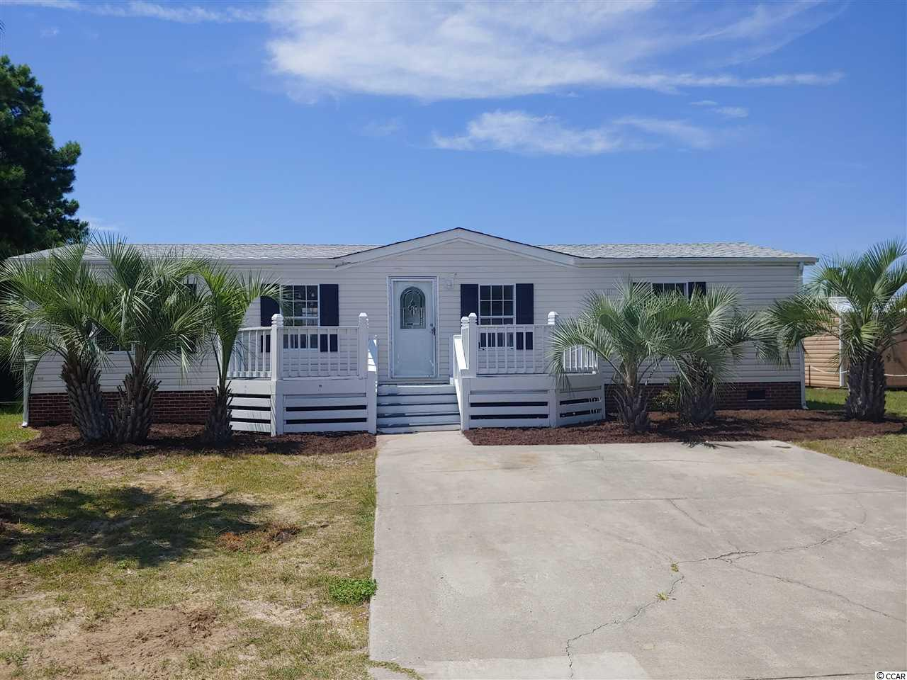 This freshly remodeled home sets in the highly sought after neighborhood of Ocean Breeze Plantation. At less than a mile to the beach, you can be there on a golf cart in just minutes or take a lengthy stroll. As you can see by the pictures this home is ready to move your furniture in. As a beach house or permanent resident it is waiting for you. Make arrangements now to see this property as it won't last long!