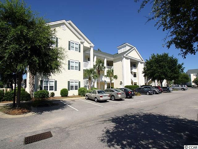 """Beautifully furnished unit that fits most criteria. The view from the screened in balcony is of a large pond with plenty of wild life fowl. gated community, near the beach, nicely furnished, lots of amenities e.g. multiple swimming pools, tennis courts, golf cart parking and close to Main St with clubs, grills and shopping. Access to the beach parking is only one block away. Two entrances to the community. One off Hillside Dr & one off 2nd Ave. Lowes, Walmart Home Depot & many smaller shops are very close by. You'll love the high end furniture and it has only been used as a second home. Ocean Keyes Community has fitness centers, outdoor pools, hot tubs, tennis courts, clubhouse and built-in Bar-B-Que areas and the grounds are beautifully landscaped. Firm price and when you see this you'll agree that it is priced to sell. This one lives up to your expectations. Let's call this one """"A Move In The Right Direction""""."""