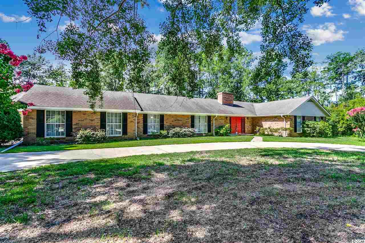 Look no further! Great value for this 5 bedroom / 3.5 bath home that is priced to sell! Enjoy neutral colors, upgraded flooring, brick fireplace, oversized attached garage and detached 1120 square foot garage and workshop!  Located close to CCU, HGTC, Conway Hospital, Shopping and Golf!  Don't Delay!