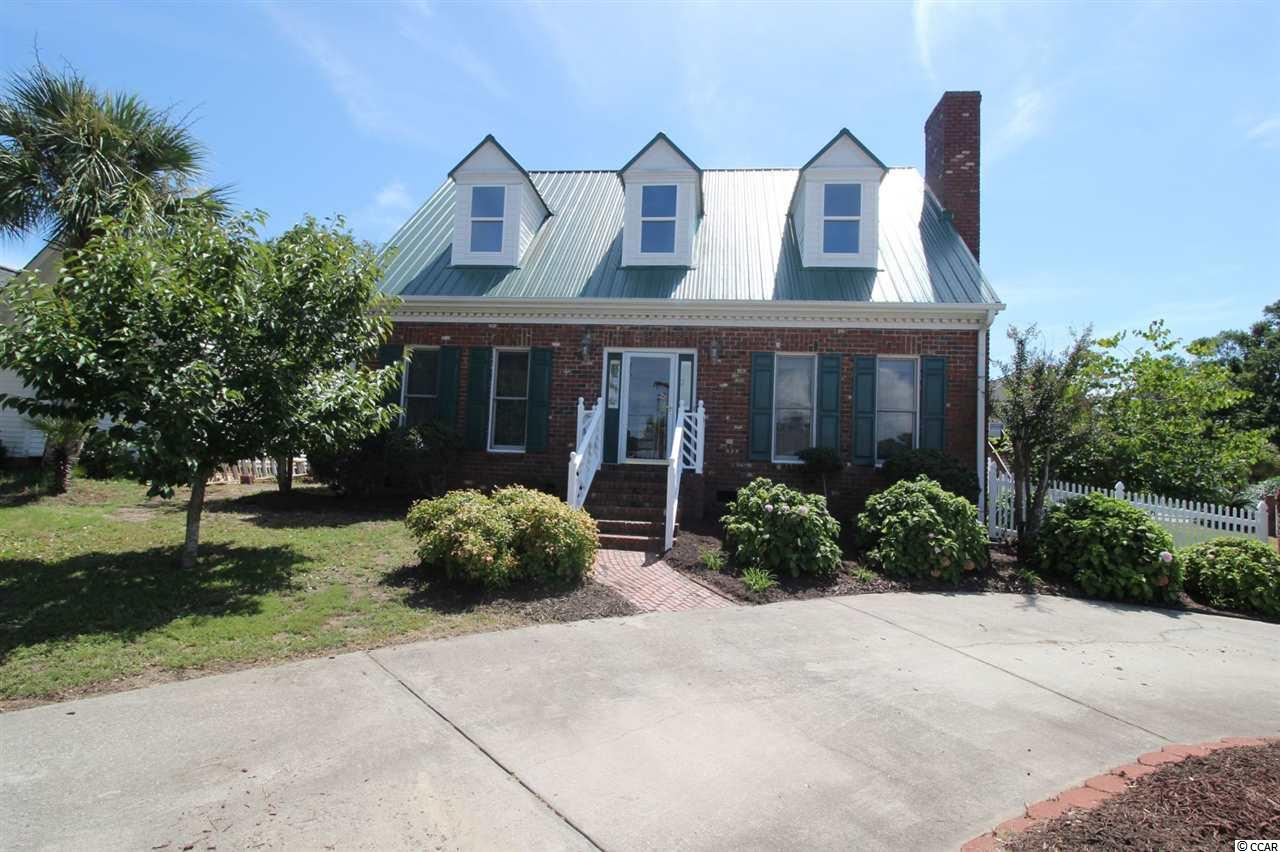 Grab a slice of paradise when you buy this Beautiful All Brick Home in North Myrtle Beach!  Nestled in a neighborhood without HOA fees, one block off Sea Mountain Hwy behind Chapel at the Sea, you will find this well-maintained 1-1/2 story three bedroom two and a half bath home. On the corner of Hunter and Allen Streets with a semi circular driveway, large fenced in yard, great landscaping, and patio area in the back.  Wow - you are so close to Cherry Grove Beach with shopping, dining and lots of activities close by. Enter the home to a warm and inviting living area with fireplace, and good flow into the dining/kitchen area.  Kitchen has a peninsula with breakfast counter and down draft stove/oven and is loaded with cabinets.  Perfect layout and great space to create many wonderful gatherings. The laundry room is off the kitchen and there is a 1/2 bath for your guest too!   The large Master bedroom is located on the main floor and has a walk-in closet, full bath with double sinks, linen closet and tile floors.  Upstairs you will find two bedrooms, full bath, and lots of storage in the eves both in front and back of the home.  Keep the breezes inside too with ceiling fans in all the bedrooms and the living room. Store your lawnmower and beach chairs in the attached storage area.  A well maintained  home with new windows upstairs and the roof and both  HVAC systems are just a few years old.  Don't just dream of a home near the beach, check out this affordable home just a golf cart ride away!