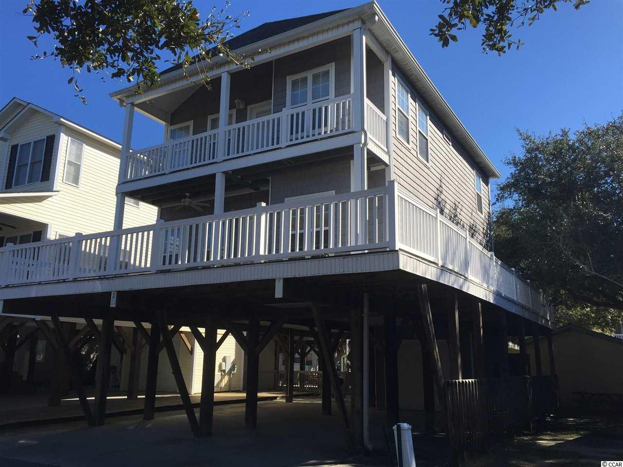 If you are looking for your place at the beach, THIS IS IT!  Located in the award winning Ocean Lakes Family Campground.  Over 310 acres of family fun waiting for you.  This home is located in a very unique area...East Canal Lane runs along a small creek within the campground.  Sit on your porch and watch the ducks and swans swans swim by....some homes are so close together that all you can see when you sit on your porch is the deck of the home in front of  you!  Not at this one....nature awaits you...beautiful place after the sunsets to sit and relax.  Large outside porch with deck furniture.  Let's go inside!!!  Inside this home is a very spacious living area.  Two sitting areas offer an area for those that want to watch TV to sit and have fun while the other sitting area offers ample room to sit and talk or read a book, all while everyone is still together.  Large kitchen area and fully stocked too!  Downstairs there is a queen bedroom with a private full bath.  There is also a half bath downstairs as well.  Upstairs there is a large master bedroom with a king size bed and private access to the upper deck.  Large walk in closet and a private full bath.  Full size washer and dryer located upstairs for convenience.  There is another large queen bedroom with large closet.  There is another bedroom with 2 sets of twin on twin bunk beds.  These two rooms share a Jack and Jill bathroom!  This home is offers an abundance of natural light as it has many windows located throughout.  Attached shed is located downstairs and there is plenty of room for parking cars.  Nice area for grilling and sitting outside and enjoying the weather.  Outside enclosed shower with hot and cold water also.  This beach house is less than a two minute walk to the beach and a short walk to the recreation center, pools and water park.  This is a great opportunity to own your very own beach house.  Great rental potential!!