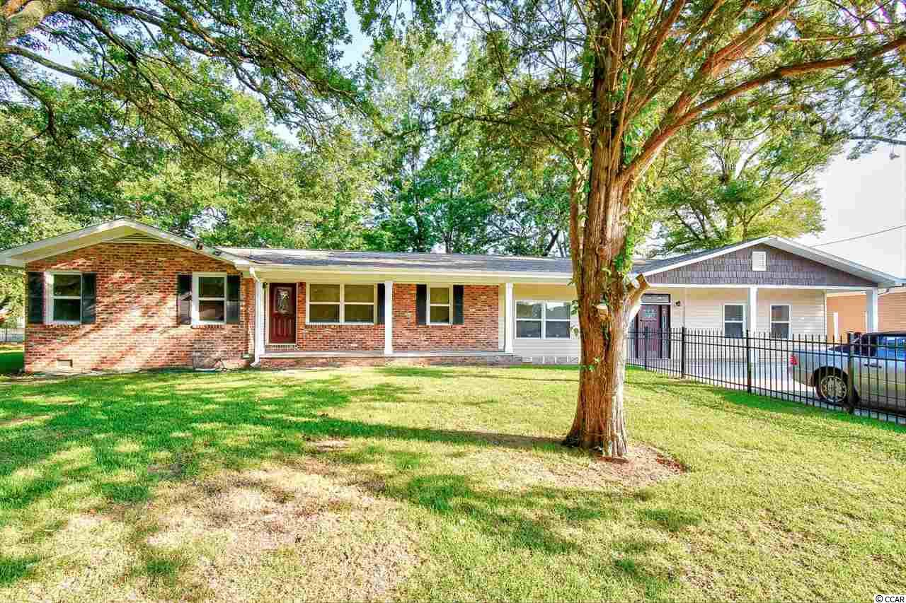 LOCATION, LOCATION, LOCATION! This beautifully remodeled ranch style home is in the heart of Myrtle Beach on a large fully fenced corner lot. This 4 bedroom 2.5 bath home is just a few blocks from the beach and a 5 minute ride to Coastal Grand Mall, Myrtle Beach International Airport, and Broadway at The Beach. The kitchen boasts granite countertops and stainless steel appliances. Enjoy summer afternoons in the backyard under the gazebo while the kids swing and slide on the built-in playground. This home has plenty of parking in the the main driveway where up to 6 vehicles can be parked or you can use the 3 car garage. This is a a true one of a kind property that wont last long. Schedule a showing today before this hidden gem is gone.