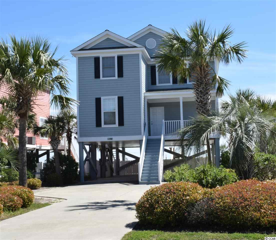 This gorgeous 4 bedroom/3 bath home has recently been upgraded to include pool decking and resurfacing, landscaping, painting, hardwood flooring refinished, new furnishings inside and outside and more!  You will love the views from 2 oceanfront decks (a rare find!) and the private walkway to your beach fun!  This home has been professionally decorated with beautiful furnishings.  With double-bay parking underneath the home (also a rarity on the oceanfront in Surfside!) you have ease of entering/leaving without shuffling around vehicles!  This home has TWO master suites with entry onto spacious deck!  From the great room TWO sets of sliding doors and side windows allow lots of natural light as well as beautiful views of the beach and ocean from every angle.  Enjoy the sounds of the waves gently rolling onto the shore as you dine or sleep!  The large, well-manicured, privately-fenced yard yields room to stretch out and enjoy pool activities, picnics, or playing with the pets!  The large, sparkling blue pool has room for family and friends without being crowded.  Don't miss the opportunity to own this unique, gorgeous beach oasis!  Call today!