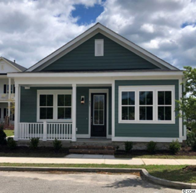 "Looking for a single level home in ""Downtown"" Market Common?  This 2 bed 2 bath home will boast hardwood, tile, and carpet flooring.  Granite counter-tops, smooth 9 foot ceilings, and a custom trim package.  You can enjoy all the sites and sounds of the Market Common from your covered porch.  Located a short golf cart ride from the beach, Savannah's Park, and amazing amenities center.  The Market Common offers a unique lifestyle that is not duplicated along the Grand Strand.  The proximity of this home will allow you to walk to ""Downtown"" Market Common.  Act now and you can pick colors, flooring, counter-tops and more."