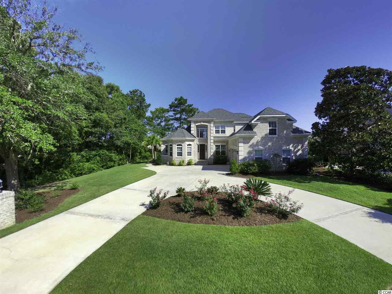 Welcome Home to this custom built 4-bedroom 3.5 bath brick home with stucco accents in Heritage Plantation. The majestic views of the marsh and the Waccamaw River from your new home will not disappoint! The attention to detail is a must see with crown molding throughout, tray ceilings and detailed woodwork. From the minute you drive into the circular driveway and walk into the two-story entry, you immediately feel relaxed and at home. Engineered hardwoods and tile throughout the main floor. Open kitchen with solid wood cabinets, range with double oven plus oven/microwave wall unit, granite countertops, tile backsplash, eat in area, walk in pantry, large kitchen island, wine cooler and views of the marsh and Waccamaw River. Have your morning coffee on the screened in porch with built in sink and small refrigerator. Step outside for lunch on the patio with built in gas grill. Master bedroom is on the first floor with TWO custom designed walk in closets, frameless shower with a floating granite seat, double sinks and a jetted tub with a window. Finish out the first floor with a beautiful study, half bath, oversized two car garage and laundry room with cabinets and sink. Take the wood stairs to the upstairs where you will find a relaxing sitting room with views of the river. There are sliding glass doors to the 2nd floor deck that runs most of the back of the house. Watch the amazing sunsets! There are three additional bedrooms upstairs. Two bedrooms share a bathroom. One of these bedrooms has access to the deck. Your guests will enjoy the quiet of the upstairs with the views and the sunsets! An additional bedroom has a private bathroom. All this and an unfinished walk in storage area above the garage. The possibilities for this room are endless! Did I mention the view of the Waccamaw River! Sit and have your coffee while taking in the majestic view of the marsh and the Waccamaw River. You will not be disappointed. Some features to mention are the lifetime warranty gutt
