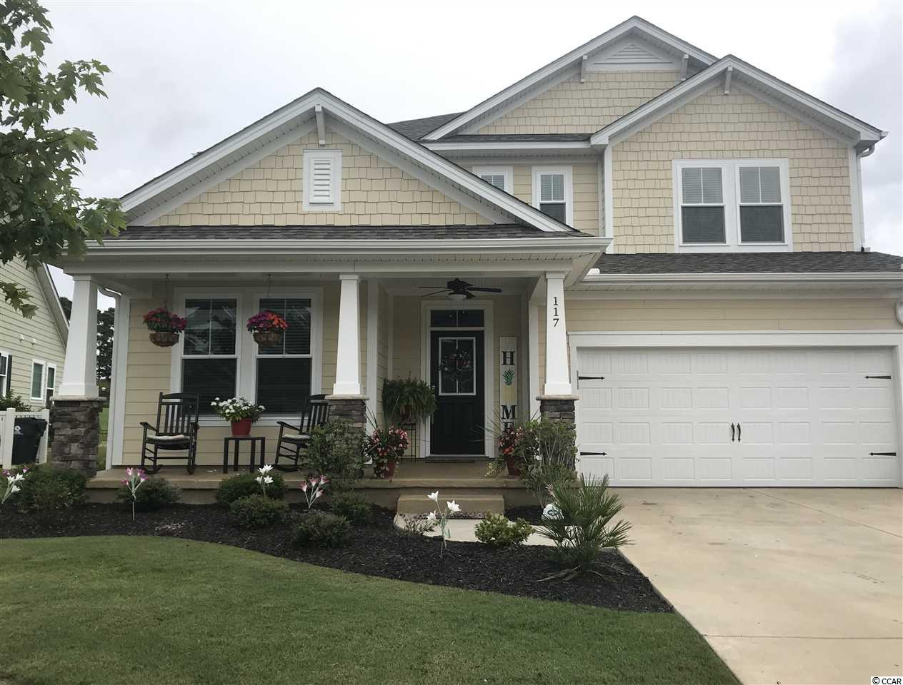 Beautiful home in mint condition located on 18th hole of TPC  myrtle Beach Golf Course. 5 BR, 3 1/2 bath, many upgrades and features. 1st floor Master, Ceiling fans in every room. Open floor plan. Minutes to beach and Marsh walk.