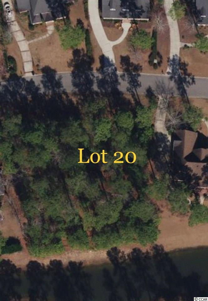Lot 20 on Stonington Dr. is a beautiful wooded lot on a pond in the prestigious community of Collins Creek. This gated community features a boat launch, clubhouse with pool, playground, and much more!