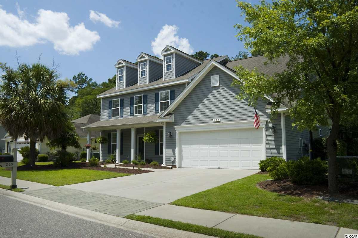 """55 PLUS , CAROLINA  FOREST AREA . MASTER, FULL BATH, HALF BATH,  LIVING ROOM, DINING ROOM & FAMILY ROOM ON GROUND LEVEL . NEVER GO UPSTAIRS UNLESS YOU WANT.    Amazing opportunity to purchase this home in Myrtle Trace Grande, a 55+ Community , walk to  Burning Ridge Golf Club. Ideally situated on a large & private lot that has no homes built across the street and a backyard that meets with a nature preserve. The setting is perfect for that buyer looking for extra privacy and tranquility. Interior features of the home include: formal dining room, open floor plan, 12 FOOT Ceilings, Floor-to-Ceiling Windows for extra natural light, Great room with hardwood flooring & gas log fireplace with built-Ins. The first floor master bedroom features a large walk-in closet, tray ceilings, & a spacious master bath with double sinks, stand up shower & garden tub. On second floor are 3 bedrooms plus a large bonus room with built-in book shelves & extra storage. There is a large walk-up attic for all your boxes.  The Kitchen area offers stainless steel appliances, quartz counter tops, breakfast bar, tile back splash, butlers pantry & a work island.   All appliances, fire pit, & garage workbench convey.  Exterior features include a rear screened-in porch, patio area for grilling, two-car garage, and a spacious backyard.   Myrtle Trace Grande amenities include a clubhouse, community pool and hot tub for your enjoyment. Perfectly located within minutes of Conway Medical Center, shopping, dining, golf, and all that the beach has to offer. Call today for a showing ! 12 MILES TO SURFSIDE BEACH & MYRTLE BEACH AS THE """" _ _ _ _  """" FLIES !"""