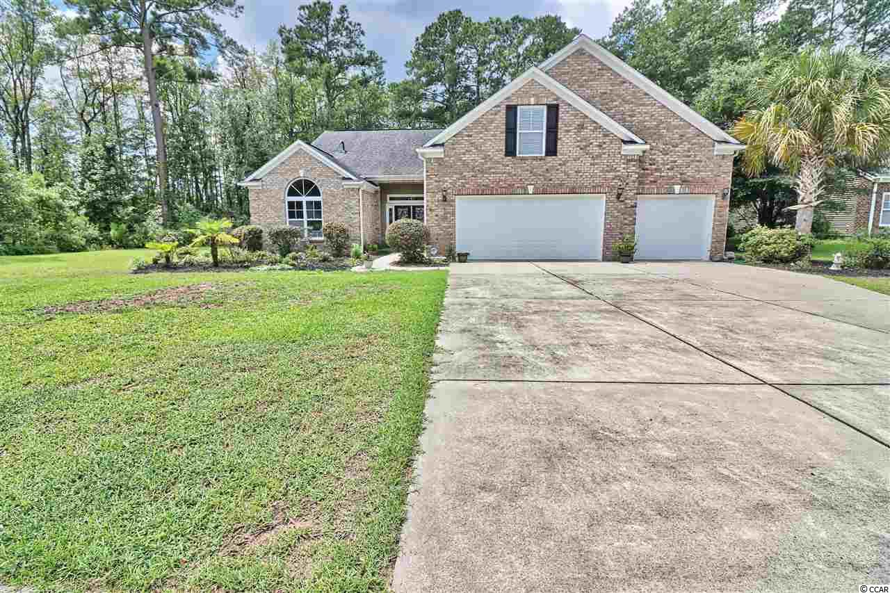 """Beautiful 4 bed/3 bath home with over-sized bonus room with full bath over an enormous three car garage, located in the desirable Heritage Preserve community. This spacious home features a great room with fireplace, master suite, home office, semi-professional kitchen, dining room, laundry room, large bedrooms, multiple storage closets, and of course a Carolina room overlooking the sprawling rear lawn. This semi-professional gourmet kitchen features all stainless appliances, cook/work island, drop-in natural gas stove, double wall ovens, custom built cabinetry, granite counter tops, under cabinet lighting, and an adjacent breakfast nook. The well-appointed first-floor master suite features a large bay window sitting area, garden soaking tub, over-sized tile shower, double sinks, and a walk-in closet. The enormous over-sized bonus room features a recreation/media area with storage closets, a full bathroom and includes a 65"""" smart screen TV. Other upgrades features include oak hardwood and tile flooring, whole-home Bluetooth surround system, security system, and a plethora of storage. Exterior features include quiet belt drive garage door openers, over-sized concrete double drive, entry sidewalk, and more! The rear of this large property offers the privacy of a natural wooded area perfect for a nature walk or flower garden. This wonderful home offers the peaceful offerings of the Heritage Preserve community, with Grand Strand attractions and eateries just minutes away via International Drive. Call today to get more information on this lovely home!"""
