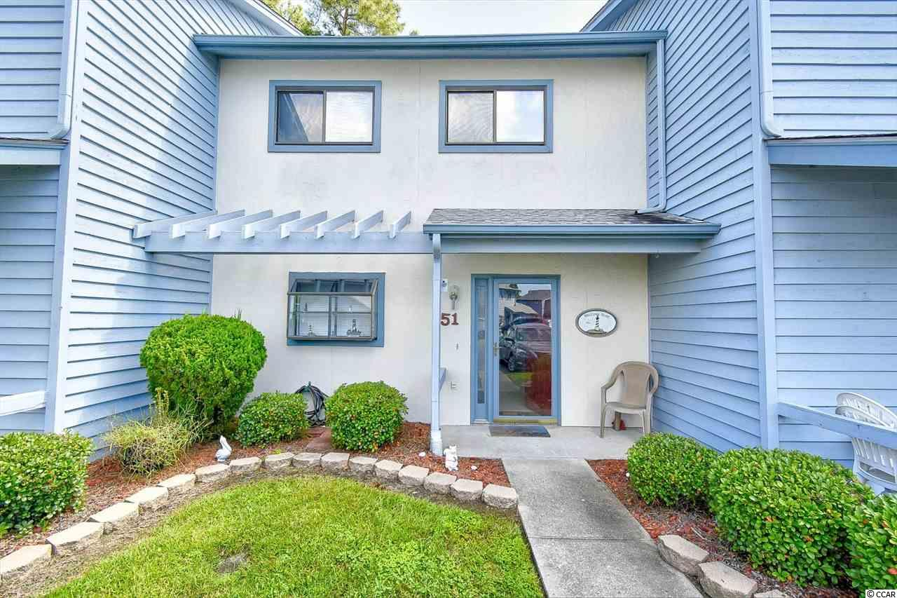 A beautiful, large 2 BR/2.5 BA townhouse with 2 master suites and full private bathrooms. This unit has been lovingly owned and well maintained by its owners! Features include ceramic floors, cooled sunroom and pull down stairs to attic for additional storage. Within minutes, you could be at the beach in Cherry Grove! Community pool tennis, and centrally located near the seacoast medical center, shopping and dining areas. This beautiful townhome is a must see and the only one available! Sold Furnished!
