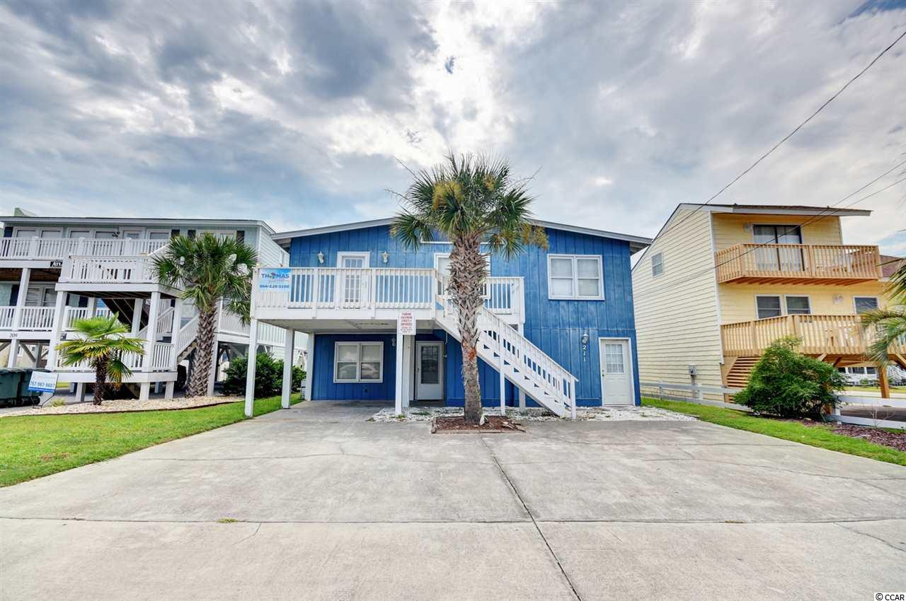 Imagine the excitement you will feel, every time you pull up at your very own Beach House. This home is located in the sought after Cherry Grove section of North Myrtle Beach. You will be drawn in by this home's curb appeal and charming 5 bedroom open floor plan with coastal decor. Location is prime with this property as you are just a stones throw from the ocean! This home has many features, including 2 dedicated living areas, split floor plan, cathedral ceilings, TWO full size kitchens, private pool, game area and so much more! Don't miss the opportunity to walk outside and feel the warm ocean breeze while enjoying your morning coffee. Call today to schedule a private viewing!