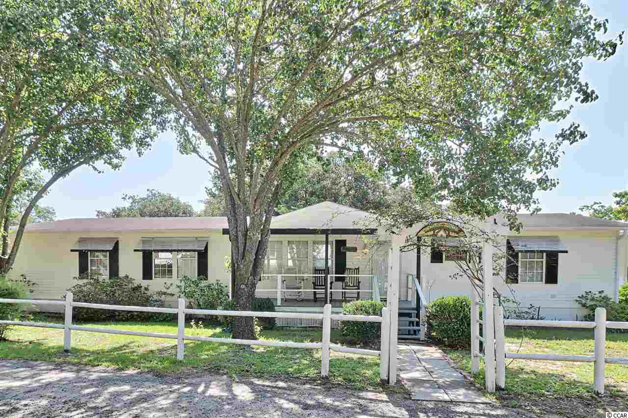 Enjoy the picturesque view of the marsh from this lovely home located in Waterford Oaks! You can relax in the shade under the majestic live oak trees, or you can take a stroll on the beach whenever your heart desires! Garden City is only about 1/2 a mile down the road, so it's an easy golf cart ride away! This beautiful home features a spacious den along with a separate living room. There is a formal dining area with gorgeous archways and upgraded laminate flooring. Ceramic tile has been installed throughout the kitchen, and there is a pantry for all of your culinary necessities. The large master suite features a walk-in closet along with a separate tub and shower. This home does have a laundry room, and it comes with the washer/dryer. There is a 27x11 Carolina room and a 17x7 front porch where you can sit back and enjoy an ice cold drink. This home has been well maintained, and the owner is providing a home warranty for extra peace of mind. The big backyard provides plenty of space to entertain, and there is a large outdoor storage building where you can keep all your beach stuff. Two cars will fit comfortably under the 23x23 carport, and there's still room for more in the driveway. The famous Murrells Inlet Marshwalk is only a few minutes away along with the Garden City Pier and Surfside Beach! There are lots of restaurants, shops, and games for everyone! This is truly a unique opportunity, and you don't want to miss out! Schedule your showing today! Square footage is approximate and not guaranteed. Buyer is responsible for verification.