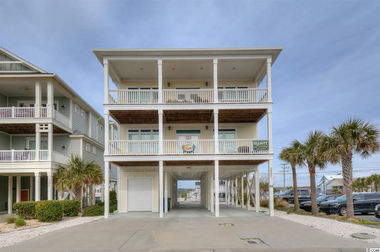 "A ""rare gem"" on the second row in Cherry Grove! This ""like new"" home on the second row boasts magnificent views of the Atlantic Ocean from the front and a canal view from the back. Double porches on both sides make it easy to access the amazing scenery. The kitchen features a large rounded island, custom cabinets, granite counter tops, and stainless steel appliances. Spacious bedrooms, impact windows, and a tankless hot water system (Rinnai) are additional bonus features. This home also has an in-ground saltwater pool and an elevator. Call today to see it in person!"