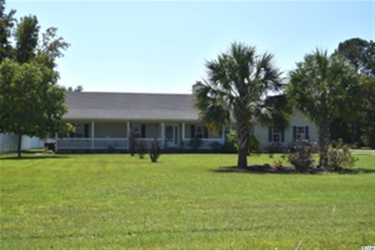 LOOKING FOR A WELL KEPT, LOW-COUNTRY HOME ON 1.18 ACRES & NO HOA FEES? THIS 3 BEDROOM 2 BATH HOME LOCATED ON A CORNER LOT, HAS LARGE BEDROOMS AND WAITING FOR A NEW OWNER. THE KITCHEN HAS GRANITE COUNTER TOPS WITH A DISHWASHER & A PROPANE GAS RANGE. THE GREAT ROOM HAS A VAULTED CEILING WITH GAS FIREPLACE & CEILING FAN TO CIRCULATE AIR. THE HOME HAS A LARGE DINING ROOM ALONG WITH A GOOD SIZED BREAKFAST NOOK. A LARGE MASTER BEDROOM HAS A MASTER BATH WITH GARDEN TUB AND SHOWER. SIT ON YOUR BEAUTIFUL COVERED FRONT PORCH OVERLOOKING THE LARGE FRONT YARD WITH YOUR OWN OASIS; PALM TREES AND FOUNTAIN. THIS HOME ALSO HAS A STAND ALONE GENERATOR IN CASE POWER IS LOST CAPABLE OF POWERING THE ENTIRE HOME. THIS HOME IS A MUST SEE!