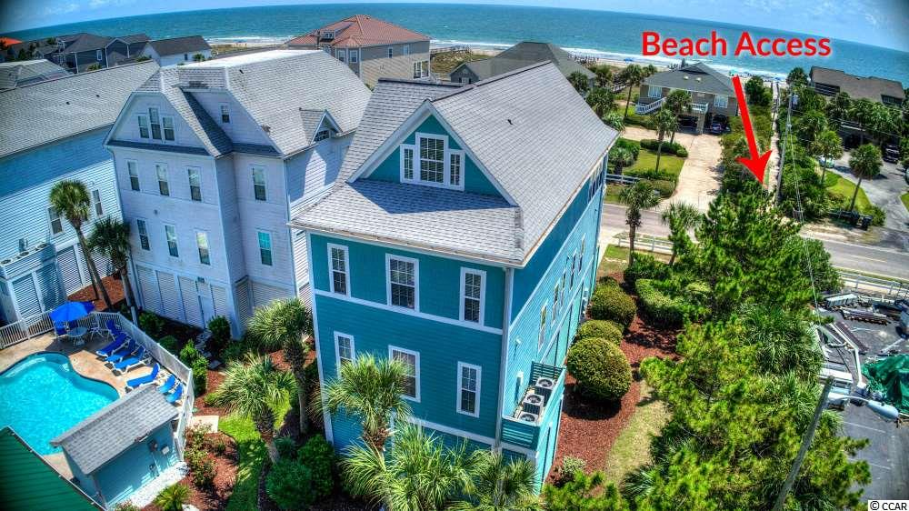 **HOA on this home may seem high but when you realize this cost covers insurance, water & sewer, trash, pest control, pool, and lawn care it makes sense** A 2nd-row Charleston style home featuring 7 bedrooms and located right across from a public beach access with a community pool! This beautiful home features the perfect floor plan and upgrades to maximize rental income. Seriously, ask for rental details. Tremendous numbers for this price point! Not only does this home gain the benefit of being right across from public beach access, but this plan also offers a garage, which is very rare in the Garden City area. The location of 1474 South Waccamaw is on the southern peninsula (the desired area of Garden City) away from all the noise and congestion. For all of you boat lovers, the news just got even better! The Marlin Quay Marina (Only Marina in Garden City Beach) is located right next door! Be sure to check out the 3D virtual walk through for an in-depth look at this lovely home!! Please note: the 7th room is actually a bonus, but is listed as a bedroom as this room will help with number of sleeps & rental income.