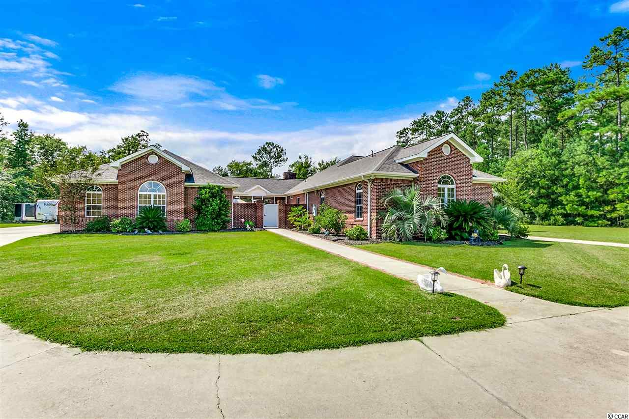 "Custom built on 1.50 acres! NO HOA!  Aynor Schools!  This home has it ALL!  All brick, 4 bed 4 bath with a 4 car garage, 16x24 in ground pool, hot tub, screened porch, courtyard, outdoor speaker system, vinyl fencing, security system and lots of privacy.  Inside you will find upgrades to die for, hardwood and tile floors, 28x23 game room with terracotta brick pavers, office with built-ins that can also be used for a 4th bedroom, large kitchen with 48"" cherry cabinets, pull out drawers and all new stainless steel applicnaces, silestone countertops, new tankless hotwater heater, and much more.  You will have your choice of rooms for entertaining, a den area with gas fireplace, living area, sun room or the game room.  The 12ft ceilings show off the true craftsmanship.  The 4 car garage is heated and cooled with a workshop and full bath.  This is a must see!  You are only minutes for the beach, shopping, dinning and downtown Conway."