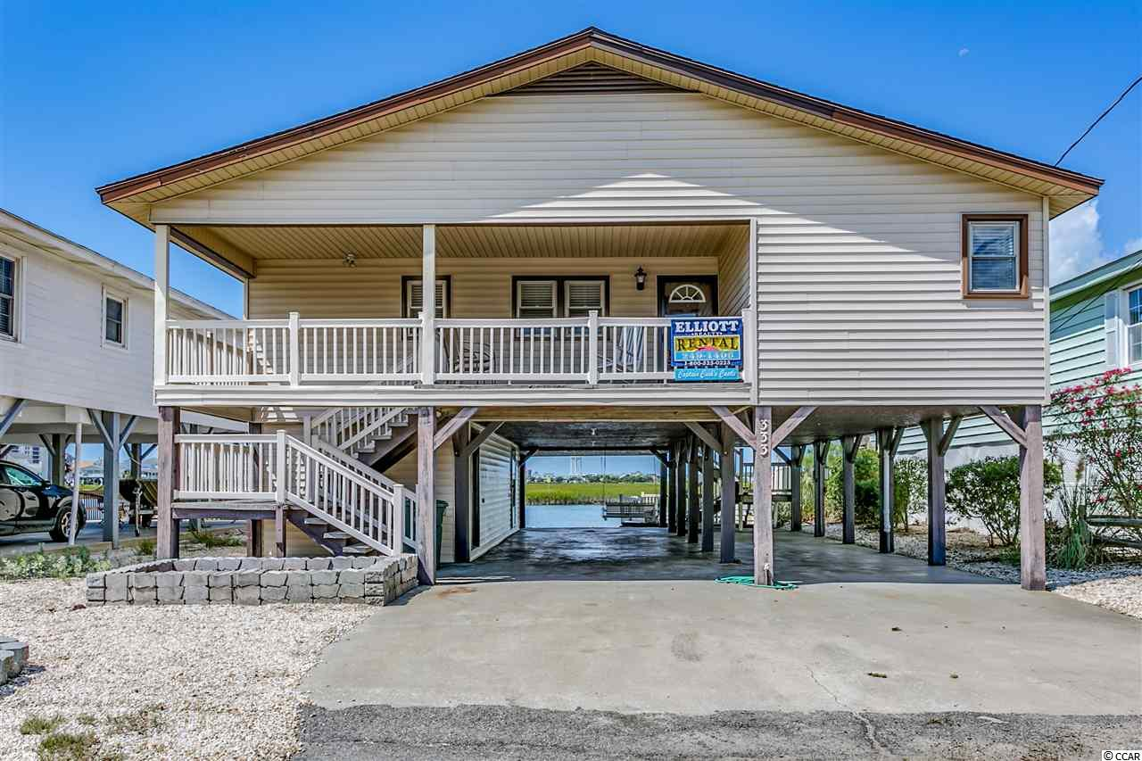 Fisherman's Dream with deep water at all tides!  You are going to LOVE this Home on a deep water main channel in Cherry Grove with amazing views and only 2 short blocks to the ocean. Home features 4 bedrooms, 2 baths on main living area but and has a separate heated and cooled area on ground floor which features a kitchen, game room and full bath.  Ground floor also has storage area and 2 showers.  This home has been recently remodeled in 2014 with new flooring throughout , new bathrooms (fixtures, vanities, sinks, faucets, toilets and tile floors), new furniture, fixtures, ceiling fans , lighting, kitchen was also updated with  stainless appliances and granite installed in 2014.  All vinyl siding, windows, roof  and porches were redone in 2007. NEW HVAC in end of 2016. Exterior features include a  Fixed Dock, floating dock and outdoor sink for fishing.  Don't miss out on this spectacular home as it will not last long! Not many deep water main channel homes come on the market. Great for a permanent home, second home or investment!  NO Dredging Fees!