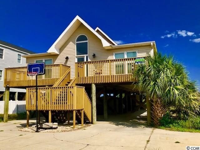 A great rental and great sand dunes, and a nice oceanfront sunning deck and a dune-walkover.  The oceanfront porch is just so inviting with the swishing of the Palmettos trees in the seabreeze.  The living area is all on one level.  More photos are coming.  It's such a good rental this Agent is having a difficult time getting in there to have inside photos taken!