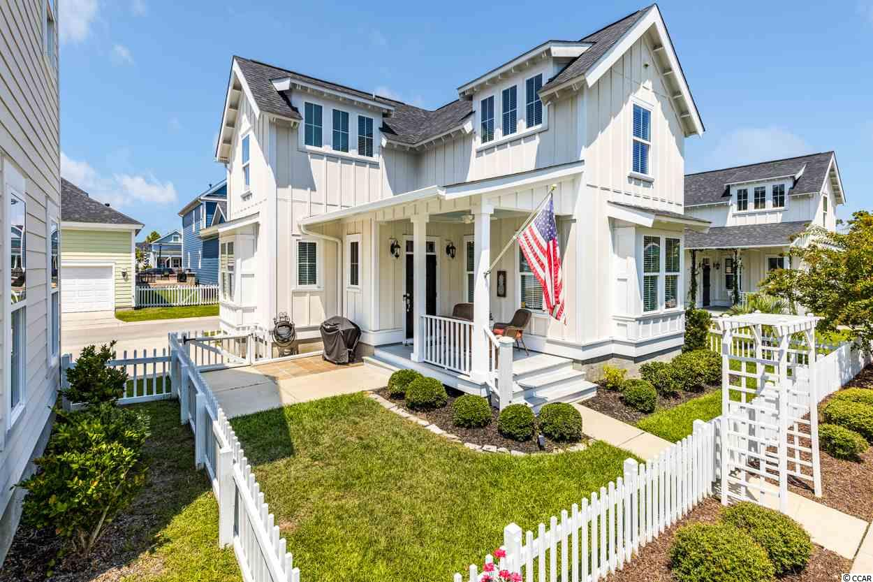 Welcome to your low country home located in Sweetgrass Square in the Market Common! This is the opportunity to be one of the TEN homes that makes up The Quarters section of Sweetgrass Square. This is low maintenance living in the community of The Market Common. The quaint front porch has room to sit outside and enjoy the completely fenced-in yard. When you step inside the front door enjoy a functional foyer with hardwood floors throughout this first level. The kitchen is spacious with an island, stainless steel appliances, dark cherry wood cabinets, granite countertops and lots of natural light. The kitchen and foyer open up to the spacious living room, walk up a couple stairs to the half bath. Upstairs is the owners' suite with two closets, a double sink and walk-in shower in the owners' bath. The second bedroom upstairs has a private full bath and in between the bedrooms is a stackable washer/dryer! This home is well maintained, freshly painted, decked with crown molding, wainscoting, and window trimming. Gutters were recently installed and so was strategic low maintenance landscaping. There is closed storage outside for beach equipment and parking for two cars. The HOA fee includes the landscaping outside of the fence, basic cable and internet. Living in this community there is easy access to the beach, dining, shopping, and entertaining... all is a golf cart ride, bike, or walk away! Trails, bowling, a dog park, a movie theater, playgrounds, and gyms are all just some parts of living the lifestyle of The Market Common. Schedule your showing of this immaculate gem today!