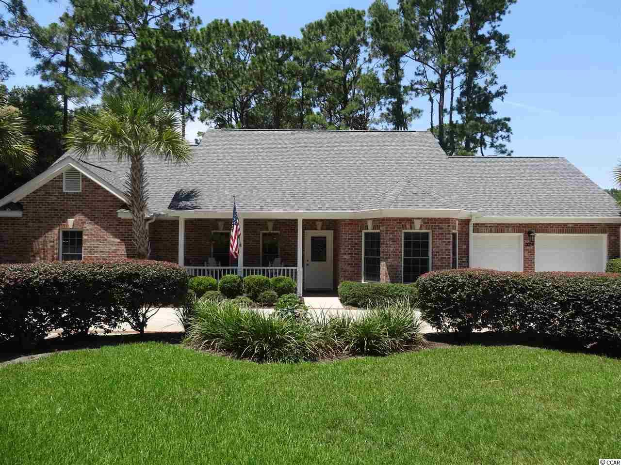 BEST OF BOTH WORLDS - Minutes to the beach and living in a gated community....All Brick one story home. Attractive, charming, and comfortable with three Bedrooms and two full baths. Schulter master bathroom shower with no leak system. This home is on the 4th fairway of the Pawleys Plantation, a Jack Nicklaus Signature Golf Course. Open Concept Living, Great Room with brick fireplace with gas logs, built-in bookcases and cabinets, vaulted ceilings, wood flooring, and ceiling fan with light. Large eat-in kitchen with center island, granite counter tops, desk area, and plenty of upscale cabinetry. Formal dining room off of kitchen, 15 X 15 bricked floor screen porch off of great room, (could easily glassed in and be heated and cooled or sliders for all season weather), brick patio, laundry room with sink and cabinets, two car garage, 4 zone Rainbird irrigation sprinkler system with new pump, and recent circular driveway. Lush landscaping, and HVAC & Roof replaced in 2018. MOVE IN CONDITION.  A perfect Coastal Lifestyle, 60 miles to Charleston and 30 miles to Myrtle Beach. Shopping, casual and fine dining, famous Pawleys Island Hammock Shops and beaches within 10 minutes drive. Huntington Beach State Park and Brookgreen Gardens 12 minutes north in Murrells Inlet.  Myrtle Beach 30 minutes north, and Charleston 75 miles south.   Pawleys Plantation Golf & Country Club information available upon request.