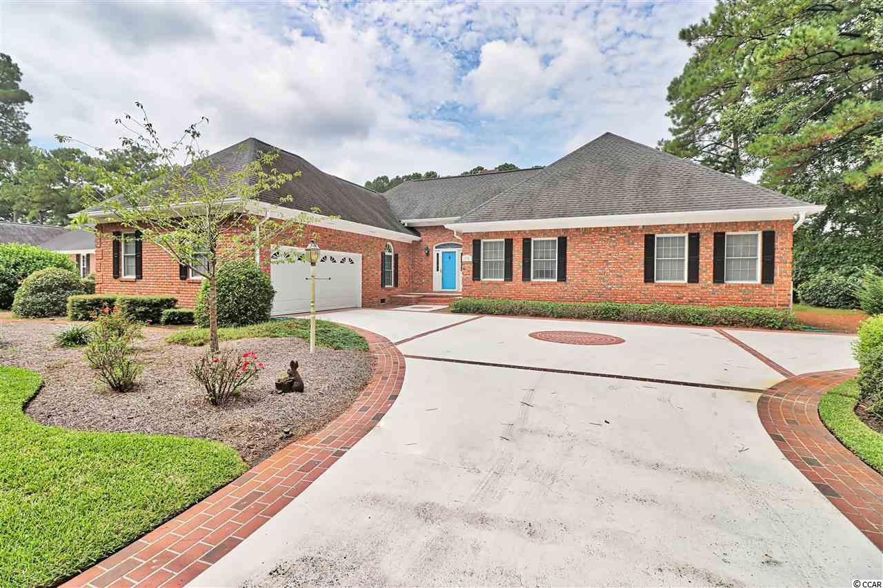 This beautiful 3 bedroom, 2.5 bathroom, all brick home is one you must see! Well maintained and many upgrades! Located in the lovely gated community of River Club. You'll notice the curb appeal and attention to detail of this home. Completely renovated kitchen with granite countertops, stainless appliances, work island, plenty of cabinet space, pantry, and breakfast nook. Enjoy the spacious family room with vaulted ceilings, all brick fireplace, wood built-ins and wet bar. Formal dining room with crown molding & plantation shutters. The Carolina room allows for plenty of natural light leading out to your patio overlooking the 16th fairway of the River Club golf course. The Master suite offers a large area,  window seat and huge walk in-closet! Completely renovated master bath with granite vanity countertops, gorgeous tiled shower, water closet and 2 linen closets! Two additional bedrooms with a jack & jill bathroom! Other highlights include: full laundry room, 2 car garage and private beach access to Litchfield by the sea! Minutes to beaches, shopping, restaurants, golf courses, Brookgreen Gardens, marinas and more. Don't miss out on this charming home!