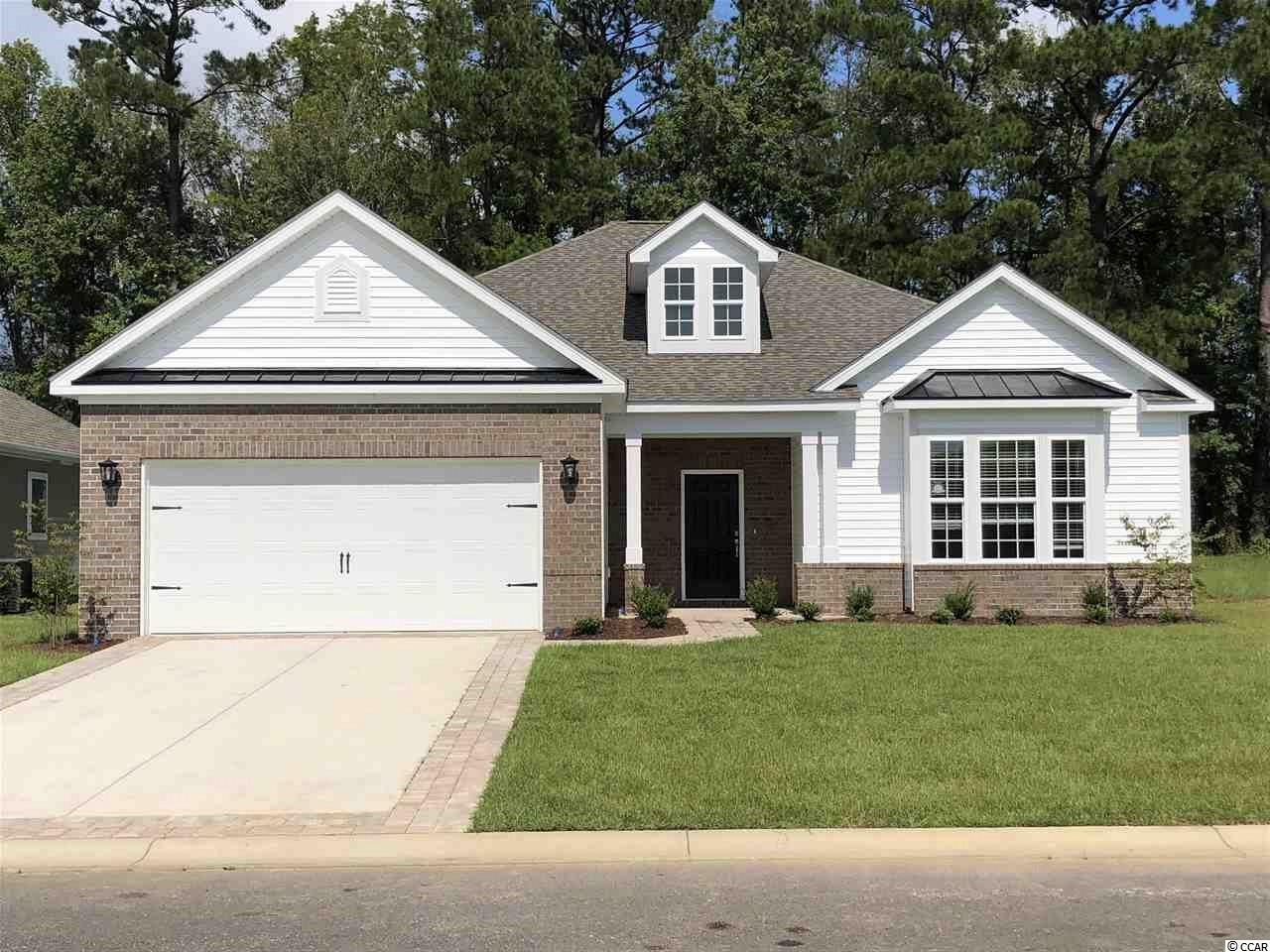 This beautiful 4 Bedroom 3 Full Bath home is ready to move in.  Hardwood Flooring in all the Bedrooms and Living Areas. Tile in the Bathrooms and Laundry Room. Upgraded Home Office Space in the Great Room.  Covered Porch overlooking a very private wooded backyard.
