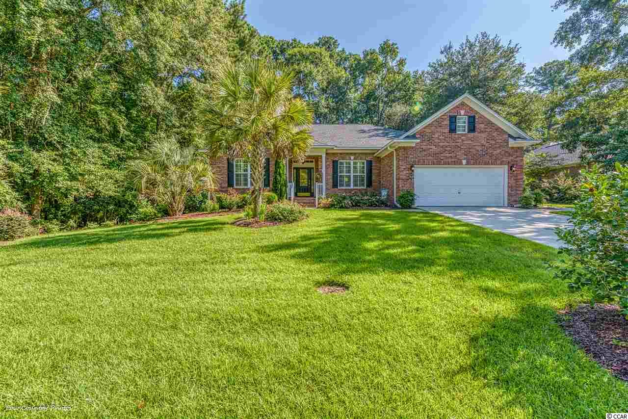 A wonderful combination of upgrades, privacy, floor plan, number of bedrooms and baths, and community.  All brick with a private lot. Open floor plan and all on one level.  The family and formal dining rooms have beautiful Hickory floors and a fireplace. The large, remodeled kitchen has an island, two bar areas, quality appliances, granite counters, breakfast nook and pantry.  There is a beautiful Carolina room with tongue and groove ceilings, tile floors, skylights, and dedicated heat and air system.  The peaceful master retreat includes dual sinks, soaking tub, new tile shower, and two large walk-in closets. Fenced yard with preservation area to the rear and left side of the home. Outdoor space includes fire pit, grilling area, and custom pavers. New roof installed 2018. Blackmoor is a well-established and neighbor friendly community offering an owner's clubhouse, pool and tennis courts. This community is nestled around Blackmoor Golf Course, Gary Player's only Grand Strand signature course, and built on the historic Longwood Plantation. A wonderful location with easy access to Huntington Beach State Park, Myrtle Beach International Airport, infinite dining and shopping options, Intracoastal Waterway, and Murrells Inlet Marsh Walk.