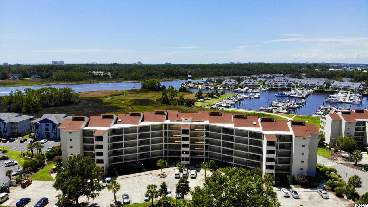 """Captivating views from the moment you walk in this stunning 2BD/2BA waterfront home. Open, spacious and full of natural light overlooking the ICW, marina and lighthouse. Relax and enjoy the coastal lifestyle from the enormous patio perfect for entertaining family and friends. A dream come true for boat lovers, this condo comes with a 42"""" boat slip with newly installed automatic lift. Easy access to ICW and ocean. Ceramic tile throughout the home, upgraded kitchen includes new cabinets with quartz countertops and stainless steel appliances. Master bedroom shares the amazing views. Guest bedroom offers flexibility with a Murphy Bed with built in features allowing work space for office, craft room or bedroom. Closets have been professionally designed for optimal storage. This ICW community offers pool, clubhouse and convenience to dining, entertainment and area beaches.  Square footage is approximate and not guaranteed.  Buyer is responsible for verification."""