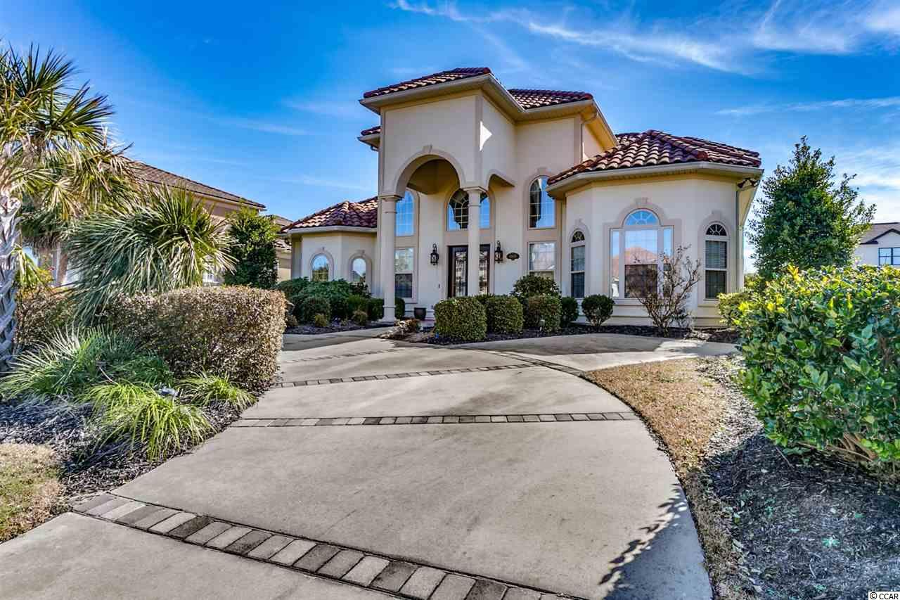 This gorgeous 4 bedroom, 4.5 bath custom home is located in the prestigious community, The Bluffs on the Waterway. The home boasts vaulted and tray ceilings, as well as beautiful tile and hardwood floors that run throughout the entire home. The kitchen is equipped with all stainless steel appliances, a flattop range, high-end cabinetry with a unique backsplash, granite counters, and a bright breakfast nook. A guest bedroom and bathroom, along with the master suite are located on the 1st floor. The master features 2 walk in closets walk in closet and master bath with double sink vanities, oversized garden tub, and luxurious tiled walk in shower, while the remaining 2 bedrooms and baths are upstairs. A bonus room upstairs would make the perfect play room, sitting area or office; the options are endless. Other features of the home are a formal dining room, home office, an entry closet, oversized crown molding, a screened in porch, and a fenced-in courtyard area. A two car garage along with plenty of storage closets throughout adds ease and convenience. The Bluffs amenities include outdoor pools, boat ramp and storage, tennis and basketball courts, owner's clubhouse, playground, and more. Close to many great restaurants, stores, shopping, golf, and approximately 10 minutes to the best beaches along the Golden Mile of Myrtle Beach. Don't miss this opportunity...schedule your showing today!