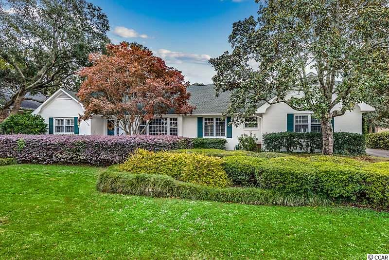 Located in the prestigious Pine Lakes Country Club, this large 5 bedroom, 5.5 bath, brick home has been beautifully and thoughtfully updated. At 4,279 square feet, this home offers large spaces and a mother-in-law suite while situated on a large, quiet lot.  The main level has beautiful hardwood floors throughout, a renovated kitchen with stainless steel appliances and granite. The large great room features a fireplace with built ins including french doors leading to a Carolina room. The Carolina room is adorned with a wall of windows overlooking the large backyard.  On the main level you will also find  the spacious Master bedroom and a beautiful renovated master bath.  An additional guest bedroom on the main floor offers easy accessibility from the master bedroom.  The mother in law suite offers a separate entrance from the outside parking area and a lock out from the home. Perfect for guests, in laws or older children since it features a kitchen area, family room, full bath and a separate bedroom.   Conveniently located in the best of Myrtle Beach.. Minutes to the Pine Lakes International Country Club, the ocean, shopping, dining, and entertainment.. This home is price well below the appraised value.