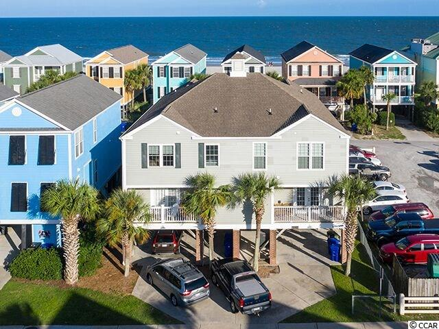 """Smack dab in the middle of Surfside Beach, 15-B North Ocean Blvd is a fully furnished, 5 bedroom, 4.5 bathroom, raised beach house with ocean views, right across the street from the beach near the Surfside Pier! Known on the rental market as """"A Jolly Good PLace,"""" this 2432 Htd. Sq. Ft. home does not have a house next to it, on the south side, so there is abundant light! Located very close to the Surfside Pier, you'll be in walking distance of some of the best restaurants on the Grand Strand! Enjoy the ocean breezes and ocean views from the two covered porches. The spacious, open floorplan provides plenty of room for friends and family to gather. There are two master suites, one on the main floor, and the other upstairs with its private covered porch with a views of the ocean. There are three other guest rooms, one with a private bath, and two that share a bath. Other features of 15-B North Ocean Blvd include: New sliding glass doors and hurricane resistant windows, street side balcony off the downstairs master suite, ground level storage, covered parking for cars, golf cart, or boat, low maintenance vinyl siding, laundry room, and plenty of owners closets.  A jolly good time will be had by all when you make """"A Jolly Good Place"""" your home."""